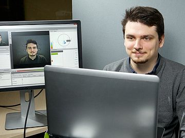 Man with a face recognition tool